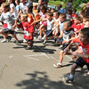 """Salem:  Seven-year-old Brady Trask, right, of Beverly takes off at the start of Saturday's """"Wicked Kidz Run""""  at Forest River Park.  Brady's grandfather is a marathon runner.    Mark Teiwes / Salem News"""