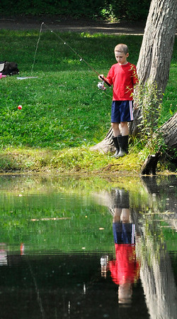 Danvers: Jackson Reid found a quiet spot along the pond for the Mike Gordon Fishing Derby.   photo by Mark Teiwes / Salem News
