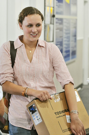 Danvers: Becca Baker of North Andover picked up a Toshiba laptop at Best Buy before she begins her junior year at Penn State.  photo by Mark Teiwes / Salem News
