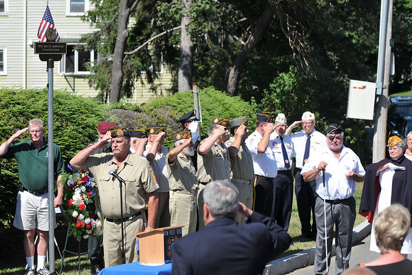Ipswich: Veterans salute as taps are played.  photo by Mark Teiwes / Salem News