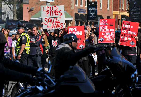 Salem:  Protesters came with signs debating the issue of loud pipes on motorcycles. photo by Mark Teiwes / Salem News