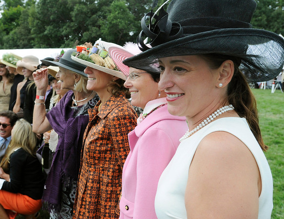 Hamilton:  Jessica Mendel of Salem posses with a group of ladies at the horse show.  The event brought out all styles of hats.   photo by Mark Teiwes / Salem News
