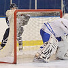 Salem: Peabody Rob Houghton looks for a pass behind the Danvers goal.   photo by Mark Teiwes / Salem News