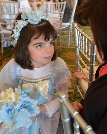 Salem: 5-year-old Olivia Davis of Peabody complete with bouquet and headress looks up at her mom Lisa.  photo by Mark Teiwes / Salem News