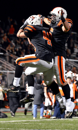 Lynn:  Beverly's Mark Giles, left, and George Kastrinakis celebrate one of the team's six touchdowns during their semifinal win. photo by Mark Teiwes / Salem News