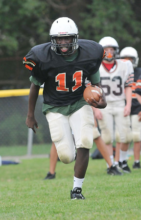 Beverly: Peter Mulumba, 13, flies down the field.  photo by Mark Teiwes /  Salem News