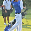 Peabody: Danvers High School's leading golfer George Merry drives the ball on the green.     photo by Mark Teiwes / Salem News