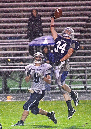 Danvers: Danvers player Duncan D'Hemecourt, right, makes a defensive play blocking a pass to Triton's Sam Wright. photo by Mark Teiwes / Salem News