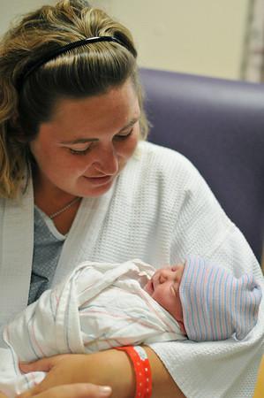 Salem: Abi Szczechowicz, of Salem, holds her new daughter Emma at the Birthplace of Salem Hospital.  photo by Mark Teiwes / Salem News