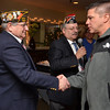 Danvers: Bruce Salaman, commander at the Salem VFW, left, and Roger Leger, commander of the Salem Veteran's Council presented Sgt. Scott Henshaw, right, a medal for his military service.  photo by Mark Teiwes / Salem News