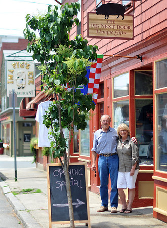 Salem: Jamie Burns, left, stands with his partner Sharon Coletti outside The Pig Next Door, a recently opened a gift shop on Derby Street.   photo by Mark Teiwes / Salem News