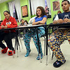Salem: Eleventh graders Oscarina Polonio, left, Ruth Guerrero, and Tyrone Rodriguez are dressed in their pajamas ready for a long night of readings from banned books. photo by Mark Teiwes / Salem News