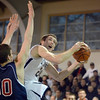 Danvers: St. John's Prep captain Pat Connaughton finds his way to the basket around Lincoln-Sudbury seven foot tall center John Swords.   photo by Mark Teiwes / Salem News