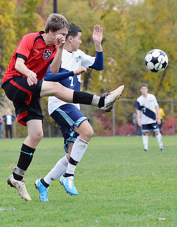 Peabody:  Salem's Jake Theriault, left, decisively clears the ball up field.  photo by Mark Teiwes / Salem News