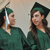 Danvers: Essex Agricultural and Technical High School Salutatorian Krystal Mannion, left,  and Valedictorian Marissa Ard both from Lawrence share a moment at graduation.  photo by Mark Teiwes / Salem News