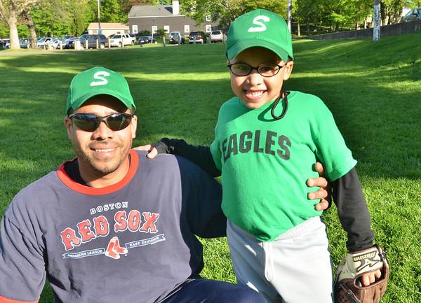 Salem: Coach Quelvis Mendez with his son Kevin, 7, photo by Mark Teiwes / Salem News