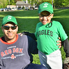 Salem: Coach Quelvis Mendez with his son Kevin, 7, photo by Mark Teiwes / Salem News