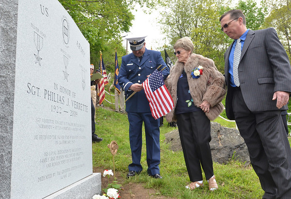 Salem: Ruth Verrette walks with her sons Paul, left, and Philias Jr. at the dedication of a memorial stone honoring her late husband Philias J. Verrette for his heroic efforts in World War II. photo by Mark Teiwes / Salem News