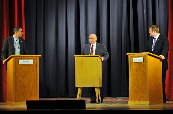 Jerry Parisella, left, and Brett Schetzsle, right, participated in a debate sponsored by the Salem News moderated by Nelson Benton, center, the paper's editorial page editor.  Photo by Mark Teiwes / Salem News
