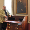 "Salem: A reading of the entire book, ""House of the Seven Gables"" is scheduled for July 4, Nathaniel Hawthorne's  birthday at the house which inspired the novel.  The property's currator, Alan Collachicco stands beside the author's desk beneath.  He will read the final pages finishing the reading.  photo by Mark Teiwes / Salem News"