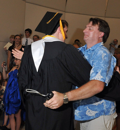 Ipswich: Connor Baker gets a big hug from his father Chris at Ipswich High School's graduation.  photo by Mark Teiwes / Salem News