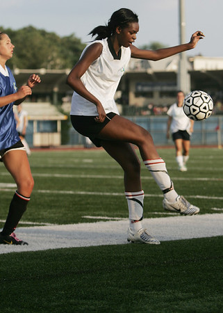 Lynn: Jasmine Bryant traps the ball in the Agganis All-Star Women's soccer classic.   photo by Mark Teiwes  / Salem News