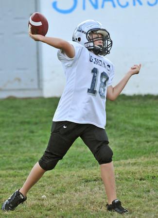 Hamilton: Quarterback Hunter Wilichoski, 11, makes a throw at a Hamilton-Wenham Youth Football practice.   photo by Mark Teiwes / Salem News