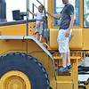 Danvers: Landon McCarthy, 3, check out a truck with his dad Ryan of Danvers during a touch-a-truck event at the Liberty Tree Mall. photo by Mark Teiwes / Salem News