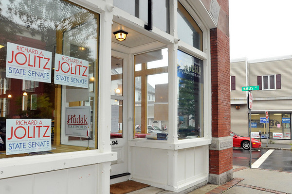 Beverly:  The Beverly Republican city committee, left, and Democratic  city committee have opened up campaign offices directly across from each other on downtown Cabot Street.  photo by Mark Teiwes / Salem News