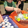 Salem: 7 year old Alex L'Heureux learns about engineering buoyancy designing a boat out of aluminum foil at the annual Read Buffam Science and Family Picnic.  Alex was able to put 22 golf balls in his craft before it sank.   photo by Mark Teiwes / Salem News