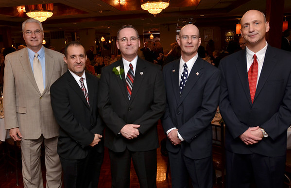 Danvers: Bruce E. Chadbourne, center, former student, DHS class of 1976 was honored for making a difference to the Danvers Public Schools at the Danvers Educational Enrichment Partnership's annual Hall of Honor Fundraiser.  Pictured from left, Dave Mcdonald, Jim Martin, Bruce Chadbourne, Dana Milne, and Jerry Clarizia.  photo by Mark Teiwes / Salem News