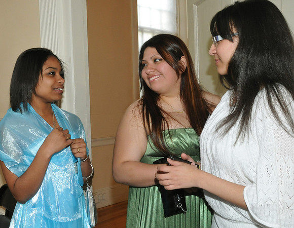 Salem:  Graduating senior Michel Santana, left, Mariuxi Santillan, class of 2007, and Yuigeily Feliz, class of 2010, chat during a celebration for the Salem Cyber Space. Photo by Mark Teiwes / Salem News