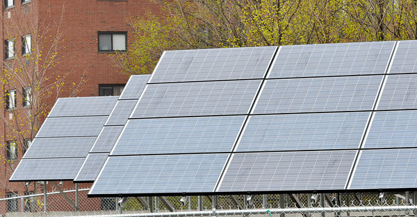 Salem: New solar panels are installed behind the Fairweather Apartments.  photo by Mark Teiwes