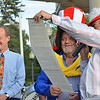 "Danvers: Kyriakos ""Kary"" Andrinopoulos, center, was voted honorary Mayor of Danvers in a rotary club fundraiser which raised over $16,000.  Danvers Town Manager Wayne Marquis, left, looks on as Larry DeLorenzo, right, of the Rotary Club of Danvers, reads a proclamation.  photo by Mark Teiwes / Salem News"