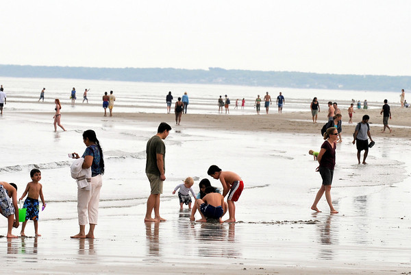 Ipswich: Beach goers walk and play along Crane Beach on Memorial Day weekend.  photo by Mark Teiwes / Salem News