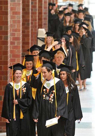 Ipswich: Ipswich High School salutatorian Rachael Comunale, left, valedictorian Ian Stewart, and honors speaker Liana Jaeger lead their class down the hall into the gymnasium for graduation.   photo by Mark Teiwes / Salem News