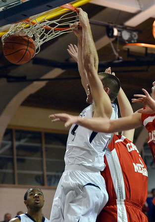 Danvers: Pat Connaughton of St. John's Prep trhows down an alley-oop dunk over Catholic Memorial.  photo by Mark Teiwes  / Salem News