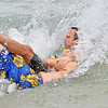 Beverly: Jon Miller is tackled into the water by Paul Liavarro who is underwater during the Anchor Pub & Grill's Anchor Dip benefiting Hospice of the North Shore and Greater Boston. photo by Mark Teiwes / Salem News