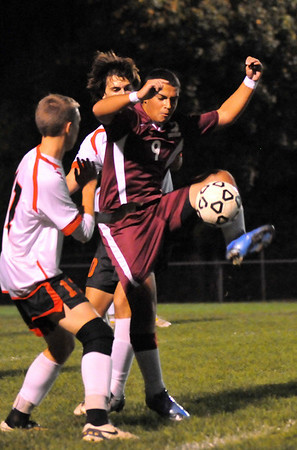 Salem: Gloucester's Paulo Lopes skillfully traps the ball as he is closely covered by two Salem defenders.  staff photo / Mark Teiwes
