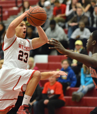 Salem: Salem High School guard Dario Medrano looks to the hoop for a shot. photo by Mark Teiwes / Salem News