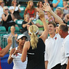 Danvers: Boston Lobsters tennis players pictured from left, Jan-Michael Gambill, Raquel Kops-Jones, Coco Vandeweghe, Eric Butorac, and Coach Bud Schultz celebrate after winning the home opening mixed doubles match of the season.    photo by Mark Teiwes / Salem News