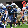 Peabody: Nathaniel Gaye bursts across Malden's line of defense on his way to score a touchdown.