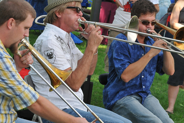 Salem: Greg Hicks, left, Craig Klein, and Mark Mullins, all trombone players in the band Bonerama, give a tutorial during the Salem Jazz and Soul Festival at the Salem Willows.    photo by Mark Teiwes /  Salem News