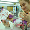 Danvers: Ashley Tardiff decorates boxes of cookie and her photo to send to soldiers.  photo by Mark Teiwes / Salem News