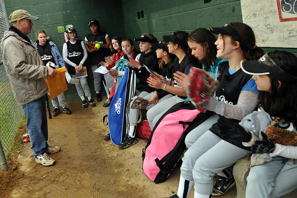 Salem: Coach Terry Griffin talks to his Sea Dogs girls 10-12 year olds softball team after a game. photo by Mark Teiwes / Salem News