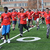 Peabody:  Youth run drills during West Welker Football Camp at Bishop Fenwick High School.  photo by Mark Teiwes / Salem News