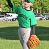 Salem: First baseman Kevin Rush, 8, tosses the ball.  photo by Mark Teiwes / Salem News