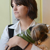 Salem: The widow of U.S. Army Sgt. James Ayube II, Lauren Ayube, holds Radar, a dog given to her by James while they lived in Germany.  photo by Mark Teiwes / Salem News