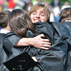 Beverly: Joe Church gives Vicky Mori big hug as the Beverly High School graduation ceremony ends.  photo by Mark Teiwes / Salem News