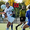 Beverly: Endicott College women's soccer captain Kayla Corbett of Danvers volleys the ball while playing against Salve Regina.   photo by Mark Teiwes / Salem News